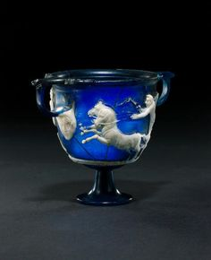 A cameo glass skyphos with charioteers Italy, first half of the 1st Century A.D.
