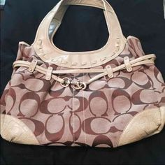 Authentic Coach Purse Price Drop Great Coach purse Brown signature bag with lime green accents small tear on inside pocket. Nothing that a cant be fixed easily Coach Bags