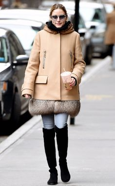 Olivia Palermo in a camel coat with fur trim, jeans and black over-the-knee boots - click ahead for more celebrity winter outfit ideas