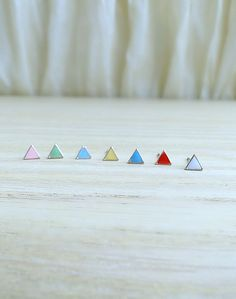 18K Gold tiny triangle earrings soft yellow by laplumeblanche