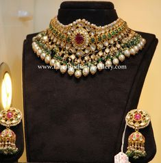 Bridal Jewelry Grand Emerald Jadau Choker Jhumkas - Grand bridal jadau choker necklace embellished with emeralds and pearl drops looks magnificent paired with traditional jadau jhumkas in gold. Pakistani Jewelry, Indian Wedding Jewelry, Indian Jewelry, Bridal Jewelry, Diamond Jewellery, Silver Jewellery, Silver Earrings, Gold Choker, Temple Jewellery