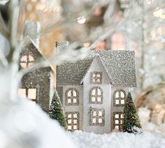 Create a snowy scene that glitters this holiday. From Pottery Barn