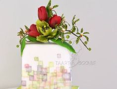 square cake with wafer paper squares and flowers (tulip, parrot tulip and aranda orchids)
