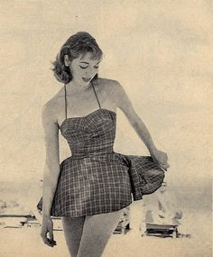 Vintage swimsuit With sweetheart neck line /bust line, And a full skirt.