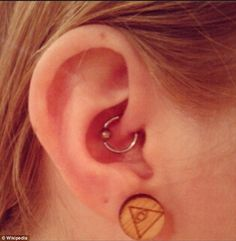 A pain specialist said daith piercings (pictured) work in the same way as acupuncture to ease migraine symptoms. Massaging or piercing this part of the ear produces pain-relieving endorphins