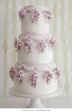 Cake Inspiration - Sugar Ruffles White ivory layered tiered cake with lavender decorations and pearl strings for a luxurious glamorous american wedding ceremonyInspiration Point Inspiration Point may refer to: Elegant Wedding Cakes, Beautiful Wedding Cakes, Gorgeous Cakes, Wedding Cake Designs, Pretty Cakes, Nontraditional Wedding, Elegant Cakes, Amazing Cakes, Wisteria Wedding