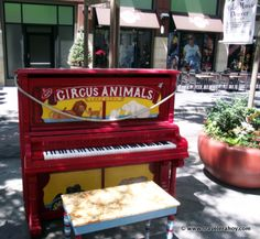 An Animal Cracker painted piano along the 16th Mall in Denver.