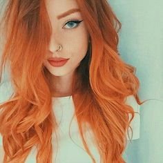 The most beautiful head of orange haircolor I have ever seen! Fifth element but better! On fire! Bold and bright hairdye! Unique haircolor but amazing! And flawless makeup! Angelic!