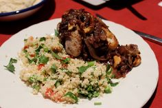 Chicken baked with onions and sumac served with a couscous, feta, fresh herb and tomato salad.