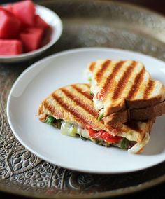 South African Cheese, Grilled Onion & Tomato Panini (Braaibroodjie) It may look like a simple cheese panini, but braaibroodjie is more than meets the eye both culturally and taste-wise Tea Sandwiches, Delicious Sandwiches, Healthy Sandwiches, Lunch Box Recipes, Wrap Recipes, Milk Recipes, Onion Recipes, Yummy Recipes, Tasty Recipe