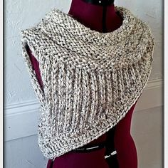 "This is an easy and quick cowl based on the one worn by Katniss in ""The Hunger Games"". It is knit in one piece using a simple two row repeat, a small section of short rows, and knitting in the round, making this pattern great for advanced beginning knitters. I have also used some basic crochet techniques for the edging, which is totally optional."
