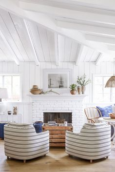 With this space, it's all about scale. 30-inch-tall barrel chairs are just the right size, plus, horizontal ticking stripes add the illusion of width, as do the slats on the coffee table.