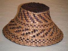 Infant size cedar hat dyed purple. cedar weaving by  Nicole Carle