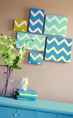 Wall art made with masking tape and shoe box lids.