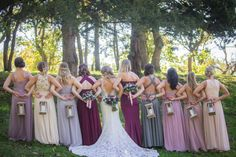 Bridesmaids and Bride - carrying handmade wooden lanterns instead of bouquets. Romantic dusty color bridesmaid dresses mauve, burgundy, gray, blush.
