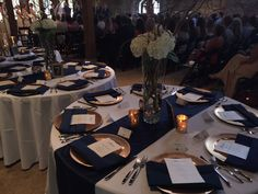 Rental: Navy Blue Lamour Satin Table Runners (15 in stock)-  Full set up with our napkins and charger plates.