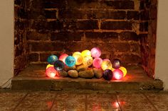 use this idea for the fireplace in the summer, or for a fireplace you can't really use! (christmas lights w/other decor)