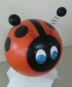 Bowling ball garden art.