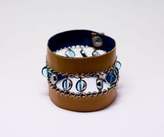 leather cuff bracelet with thin chain and turquoise coloured glass beads