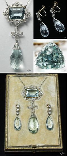 Aquamarine necklace & earrings, ca. 1920, D & J. Wellby Ltd., United Kingdom,  aquamarines, rose-cut diamonds, platinum, gold, pendant: 6.8 x 2.8 cm, semi-handmade platinum chain: 46 cm, earrings: 3.3 x 1 cm, fitted leather case