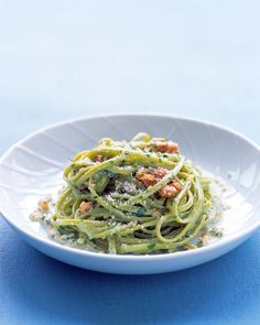 Toasted walnuts, garlic, and heavy cream form a rich, buttery sauce for spinach linguine. Toss with more walnuts and plenty of Parmesan cheese and fresh parsley before serving.