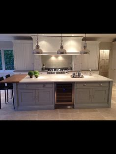 Love this combo island and the little bitty cabinets on either side of the stove Tom Howley Kitchens, Grey Kitchens, Luxury Kitchens, Home Kitchens, Open Plan Kitchen, New Kitchen, Kitchen Decor, Kitchen Mantle, Kitchen Island