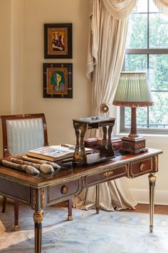 Touring the office you can see the Louis XVI style desk, custom lampshade, Matisse prints, Chinese paint brushes, and Savonnerie style carpet.