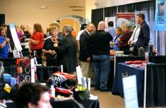 Members of the area business community network during the 2013 Tuscarawas County Chamber of Commerce Business to Business Expo Wednesday at ...
