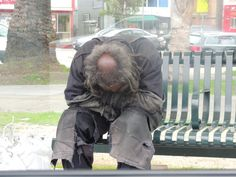 Homeless! Sleeping on the bench of a bus stop. Oakland CA!   Photography by Bonnie Wellman