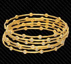 Six Designer Bridal Bangles for Hindu Weddings set with Diamonds set in 22K Gold. #mughal #designerjewelry #bridaljewelry #bridalfashion #tempusgems #indianfashion
