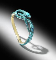 A mid 19th century Turquoise snake hinged bangle.