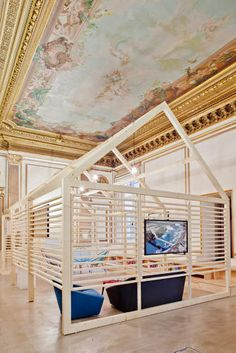 "<p>Built inside a huge 19th century palace in Paris, the marketing firm Ekimetrics divided its office into smaller ""sub spaces"" for privacy.</p>"