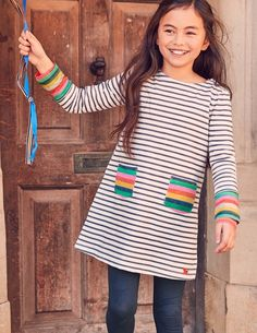 This colourful stripy dress in soft jersey is perfect for layering on blustery days in the park. And with the rainbow colours, the sun is sure to put his hat on soon. Until he does, long sleeves and thick fabric will keep off the chill while you play.