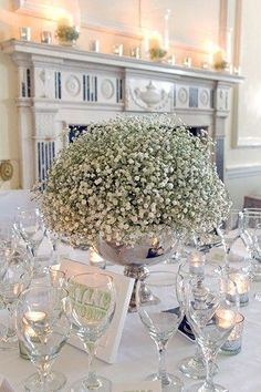 A romantic, white #wedding table #centerpiece.