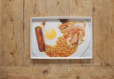 Serve breakfast on breakfast with this Martin Parr tray. The beloved photographer's blend of dry humour and anthropology is apparent here—and while the Melamine piece is entirely functional, it's a shame to cover up the 1995 photo. The image was included in Parr's book British Food, and is just one of the many culinary-focused pictures in the brilliant photographer's vast body of work.