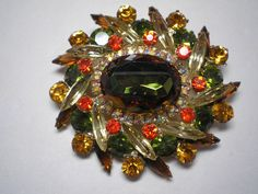 D&E aka Juliana  Brooch Heliotrope, Yellow, Orange, Topaz and Amber   Item No: 16825      Book Piece by Cleoras on Etsy https://www.etsy.com/listing/173747736/de-aka-juliana-brooch-heliotrope-yellow