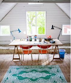 Rug, trestle, open wood, shutters not curtains.