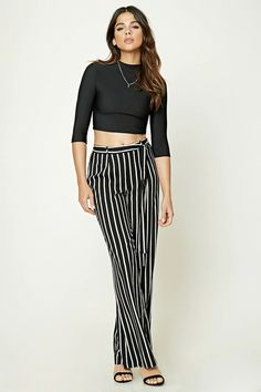 A pair of woven palazzo pants featuring vertical stripes, a self-tie belt, concealed side zipper, and a straight wide leg.