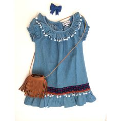 Chambray ethnic pom dress with Raine + Skye leather fringe purse = outfit perfection. www.stripesboutique.com/shop.html