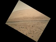 This image captured by Curiosity's Mars Hand Lens Imager camera looks toward the south, showing a portion of Mount Sharp and a band of dark dunes in front of the mountain. The photo was taken on the 340th Martian day, or sol, of Curiosity's work on Mars, shortly after Curiosity finished a 329-foot drive on that sol. Image released on July 23, 2013.