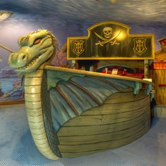 Viking/Pirate bed for your little buccaneer!  Very cool room, with the murals along with the bed.