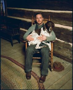 Tom Hardy...Hello there gorgeous man with a puppy on your lap...I think I'de fit on your lap with the puppy...just sayin!
