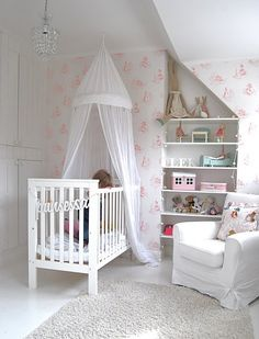 I love the idea of putting the curtain there for a young girl's nursery. It's so cute and simple. It makes it so chic!