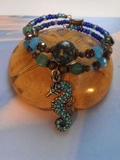 Blue crystal seahorse memory wire bracelet and by ABBGDesigns, $38.00