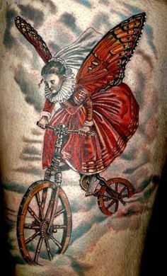 Tattoo of the Day goes to Todo for this surreal bicycle tattoo.