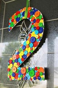 Decorate a number with buttons. Great idea to hang on the wall for a birthday.