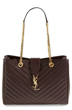This Saint Laurent leather shopper is beautiful. The gold chain and logo add a touch of sophistication.