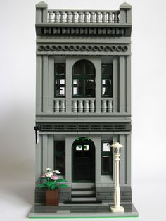 A psychiatrist's office based on part of a facade of a bank building in Brisbane. It was meant to be all grey, but that ended up looking too dull and didn't work for the office on the first floor. Instructions available through Rebrickable. Building Front, Banks Building, Lego Building, Building Facade, Lego Modular, Lego Duplo, Lego Moc, Lego Christmas Village, Lego Village