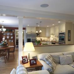 Half wall between kitchen and living room, remove wall between dining room and living room. This is perfect! Except our living room is sunken. But I love the way they've hidden the beam!