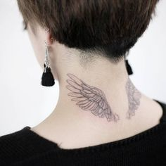 Wings tattoo on the back of the neck.